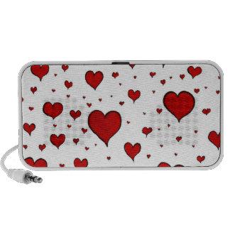 Corações tirados mão caixinha de som para notebook