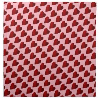 Corações vermelhos e cor-de-rosa do dia dos guardanapo