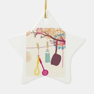 cozinha de tuscan - utensílios em floral. ornamento de cerâmica estrela