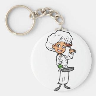 Cozinheiro chefe fêmea com um chaveiro da