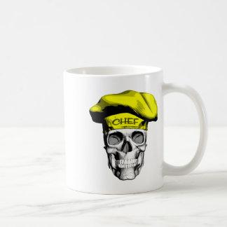 Crânio amarelo do cozinheiro chefe do chapéu caneca de café