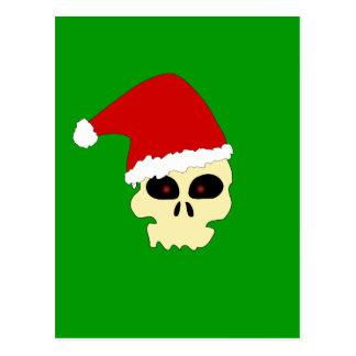 Crânio com o cartão do chapéu do papai noel cartão postal