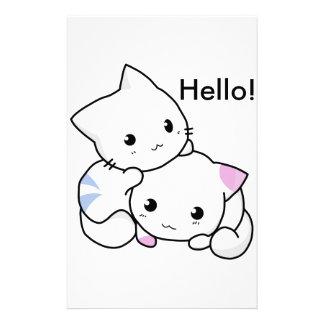 Desenho bonito do gatinho do menino e da menina no papelaria