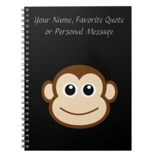 Desenhos animados da cara do macaco caderno espiral