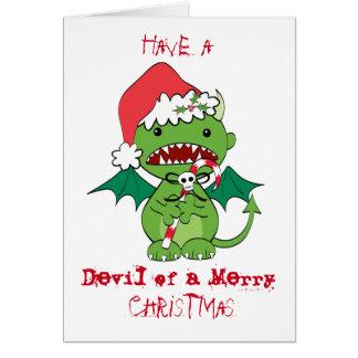 Diabo do papai noel com bastão de doces cartão comemorativo
