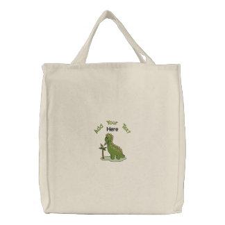 Dinossauro verde bolsas
