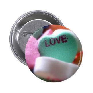 Doces do coração do amor botons
