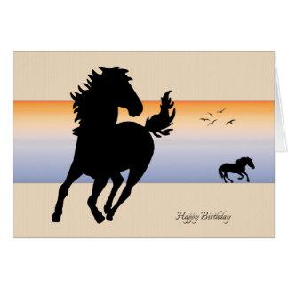 Dois cavalos da silhueta que funcionam o cartão de