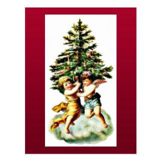 Dois miúdos vestiram-se como um anjo que joga em t cartão postal