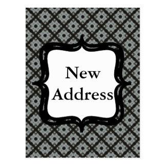 Entrecruzamento cinzento do endereço novo cartão postal