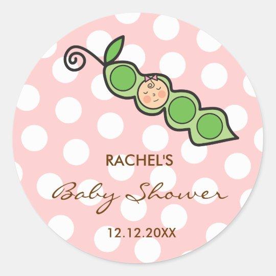 Ervilha do bebé em uma etiqueta do chá de fraldas