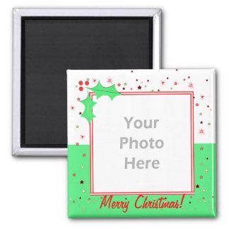 Estrelas do azevinho do Feliz Natal (quadro da fot Imã
