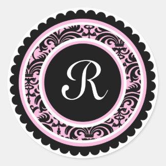 Etiqueta cor-de-rosa da inicial do monograma do adesivo