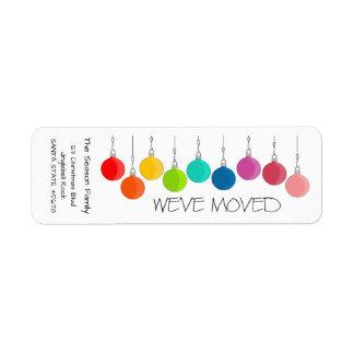 Etiqueta Nós movemos baubles do Natal do arco-íris