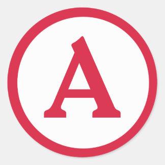 Etiqueta vermelha inicial do círculo do monograma