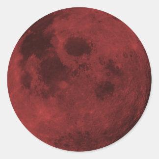 Etiquetas carmesins finais da lua adesivo em formato redondo