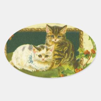 Etiquetas dos gatinhos do Natal Adesivo Oval