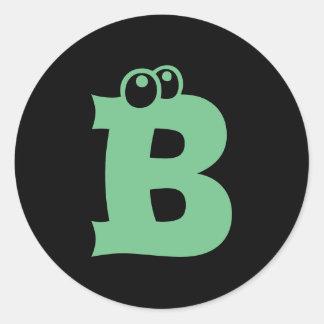 Etiquetas verdes da letra B dos globos oculares