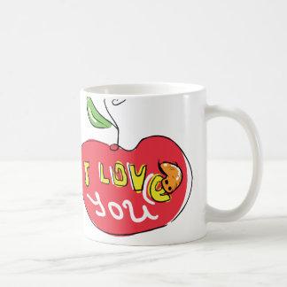 Eu te amo maçã com a caneca do chá do sem-fim