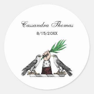 Falcons heráldicos do vintage com o emblema da adesivo