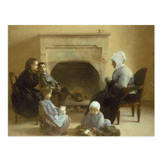 Família assentada em torno de uma lareira cartão postal