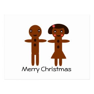 Feliz Natal do homem e da menina de pão-de-espécie Cartoes Postais