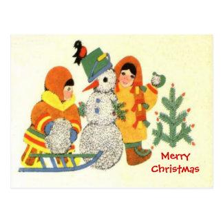 Feliz Natal, miúdos e um boneco de neve Cartão Postal