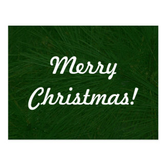 Fim do pinheiro do Feliz Natal acima Cartão Postal
