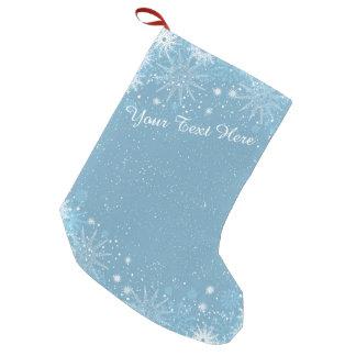 Flocos de neve na meia azul bota de natal pequena
