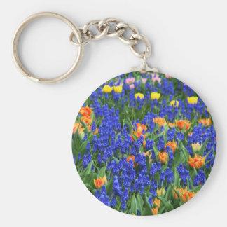 Flores, azul e laranja coloridos chaveiro