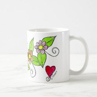 Flores e um coração caneca