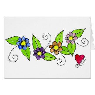 Flores e um coração cartão comemorativo