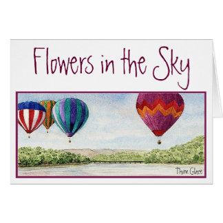 Flores no cartão de nota do céu
