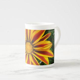 Foto alaranjada bonita da flor de Sun Xícara De Chá