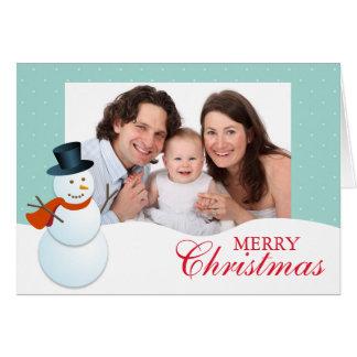 Foto azul do Natal do Pólo Norte amigável do bonec Cartao