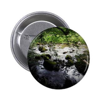 Foto da paz do rio e das rochas bóton redondo 5.08cm