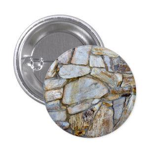 Foto da textura da parede da rocha no botão bóton redondo 2.54cm