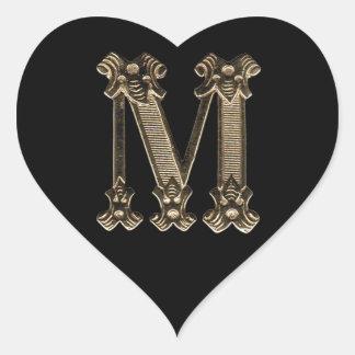 Foto inicial dourada da letra M no fundo preto