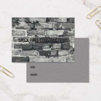 Fundo preto da parede de tijolo & branco cinzento cartão de visitas