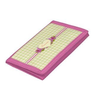 Gerânio cor-de-rosa na xadrez do vintage