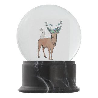 Globo da neve dos cervos e do coelho do