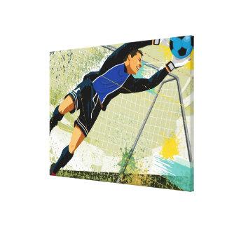 Goalie do futebol que obstrui a bola