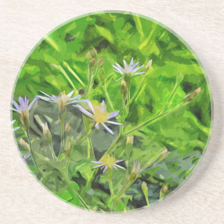 Grande áster roxo com folhas entre o abstrato das porta copos de arenito
