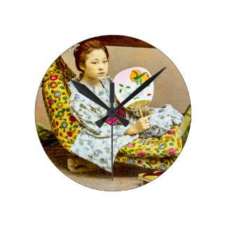 Gueixa do vintage em uma maca Japão velho de Relógio Redondo