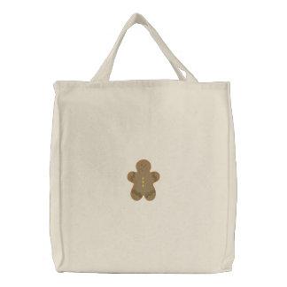 Homem de pão-de-espécie bolsa bordada