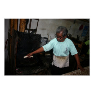 Homem que pressiona o Batik Pôster