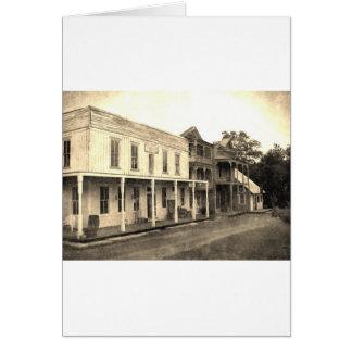 Hotel da cidade fantasma do vintage cartão