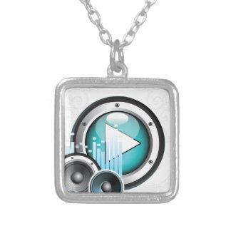 ilustração da música com auto-falante e elemento colar com pendente quadrado