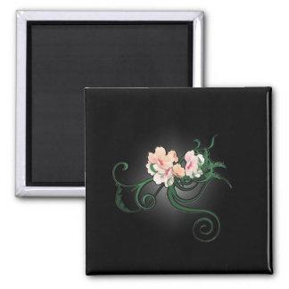 Íman Flores cor-de-rosa da flor em um fundo preto