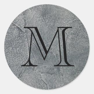 Inicial preta do monograma na obscuridade - selo adesivo